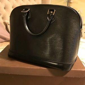 e6a0922e1867 Women s Louis Vuitton Alma Pm Handbag Black Epi Leather on Poshmark